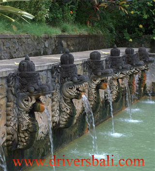 eight carved stone dragons pouring water in banjar